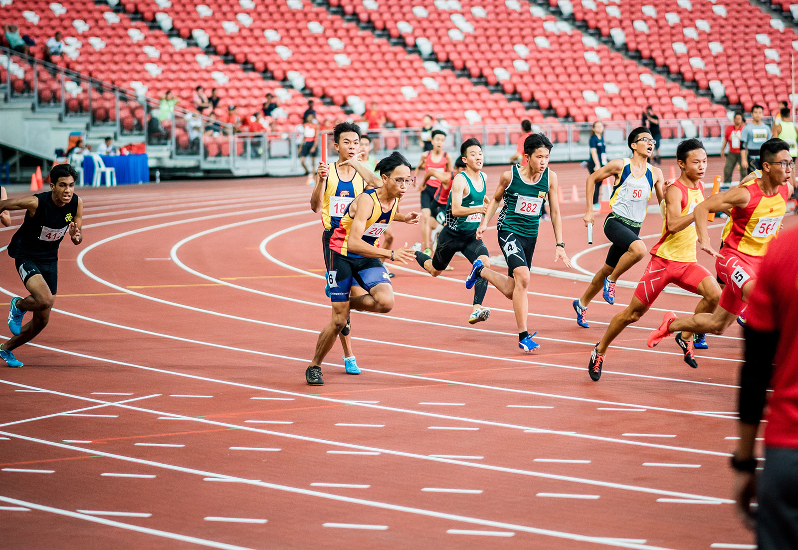 Athletes running on a race track.