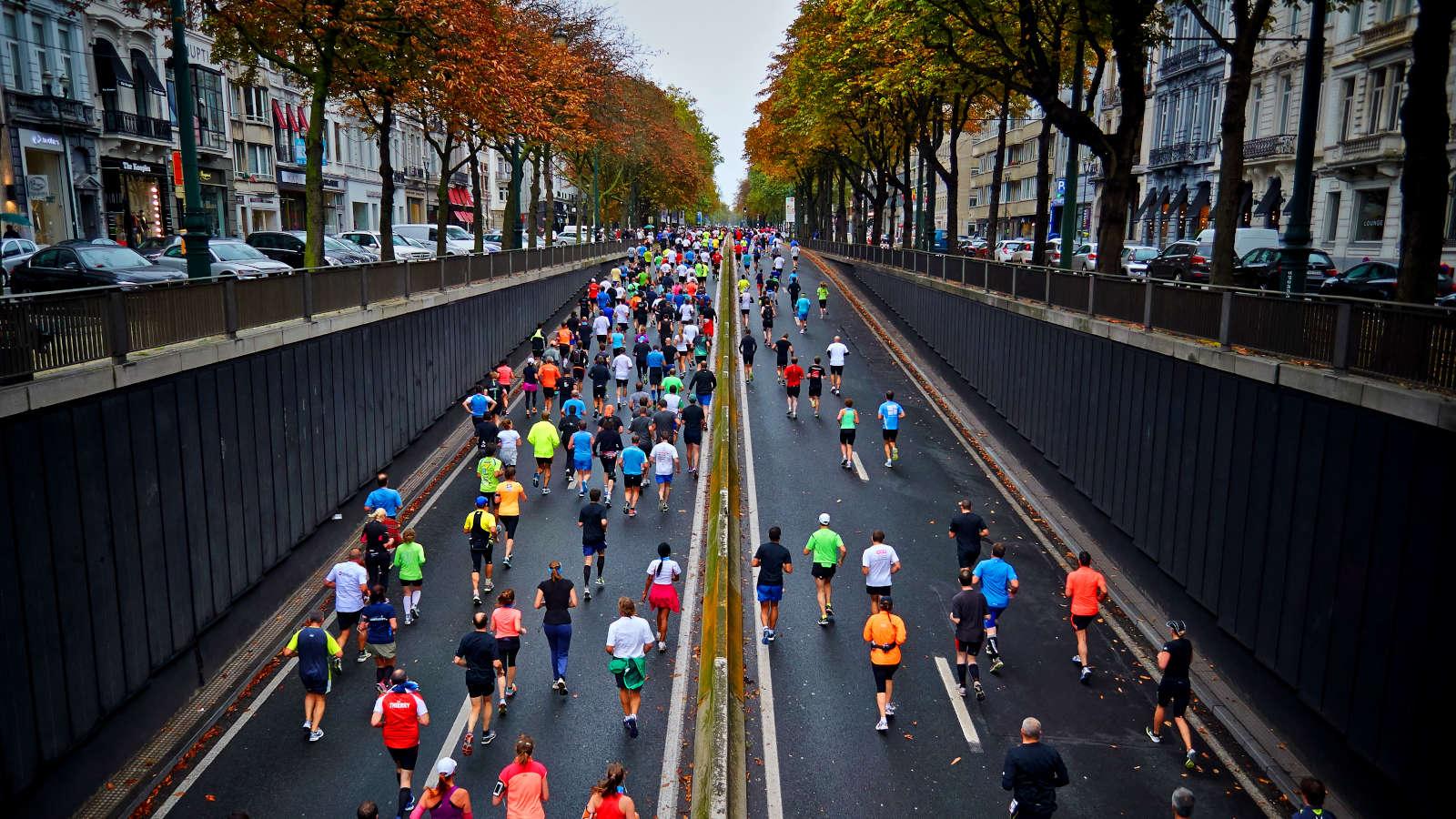 People Running On Road